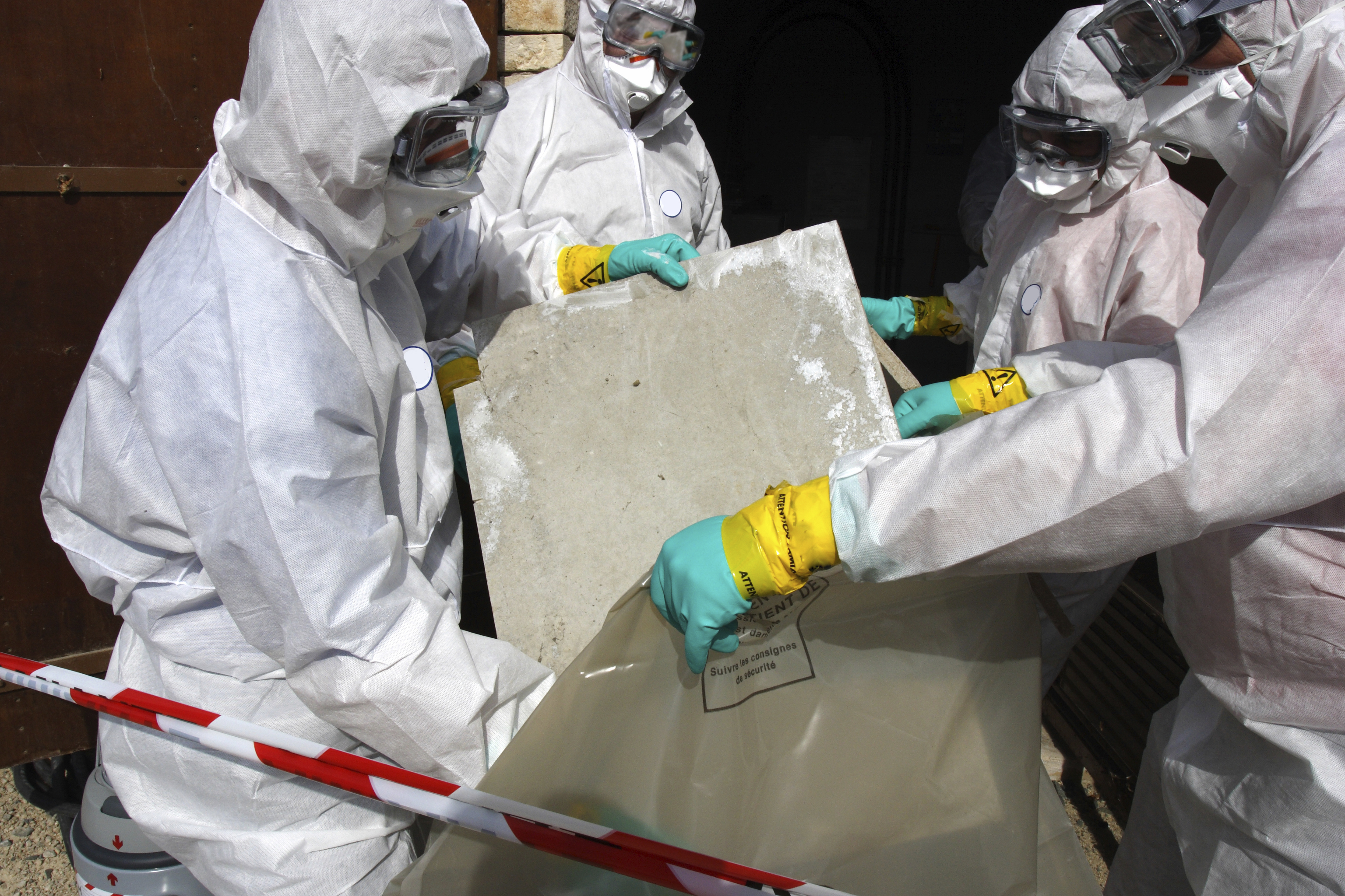 stock-photo-5094874-removing-materials-containing-some-asbestos