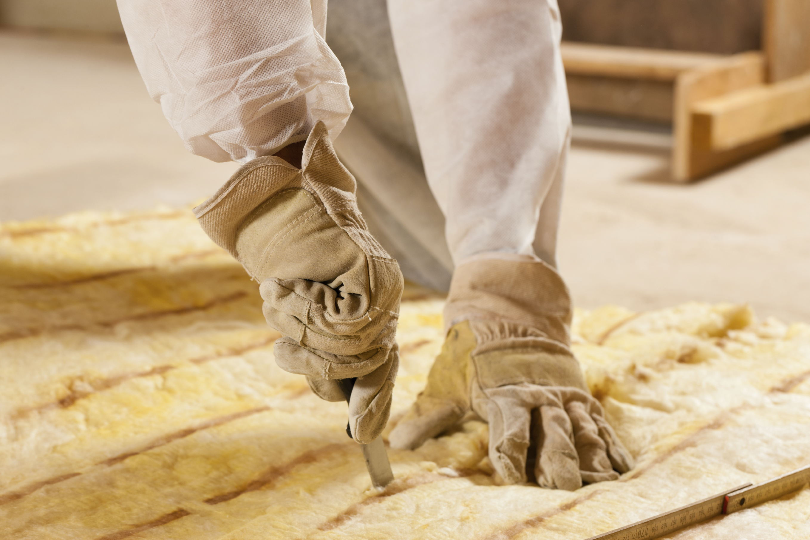 stock-photo-14641622-man-cutting-insulation-material-for-building